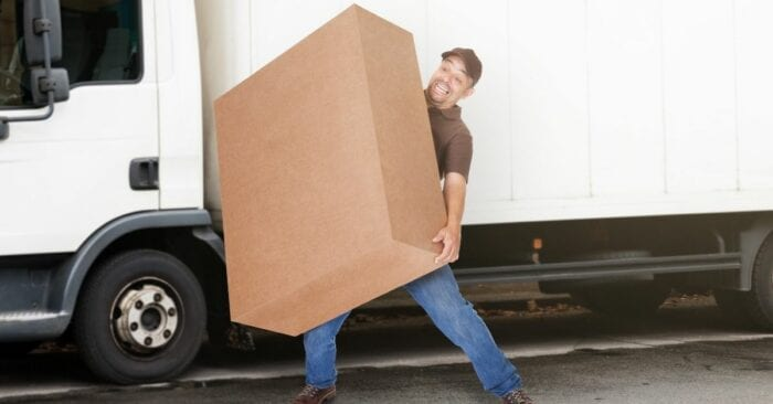 man struggling with large box